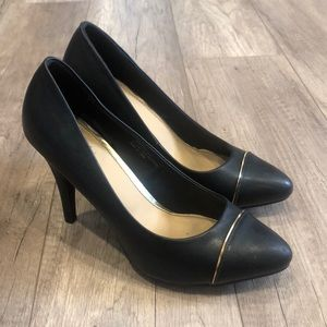 Black heels with gold stripe accent